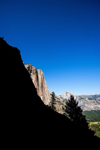 Yosemite Falls Upper Falls Yosemite National Park California Mountain Silhouette Contrast Copy Space Clear Sky Nature Blue Beauty In Nature No People Landscape Scenics Rock - Object Tranquility Tranquil Scene Mountain Peak Outdoors EyeEmNewHere Cliff Forest Tree The Week On EyeEm