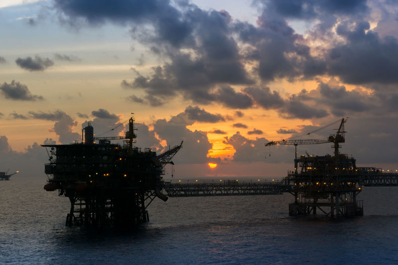 production platform during sunset Offshore Offshore Life Oil And Gas Petroleum Upstream Oil Rig Cloudy Evening Twilight Cloudy Industry Silhouette Oil Pump Drilling Rig Offshore Platform Oil Industry Factory Industry Gasoline Sea Sunset Gas Natural Gas Oil Field Fossil Fuel Crude Oil Oil Well Oil