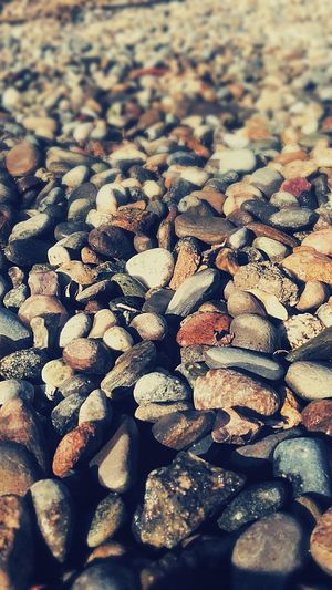 Pebbles Decorative Rocks Large Group Of Objects Full Frame No People Outdoors Nature Close-up Abundance Pebble Beach Backgrounds Day Flower Bed Rocks Tumbledstones Textured