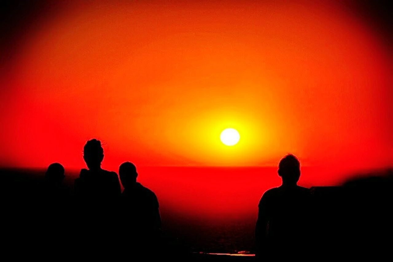 silhouette, sunset, orange color, togetherness, leisure activity, sun, lifestyles, medium group of people, fun, enjoyment, outdoors, men, scenics, nature, real people, beauty in nature, people, friendship, beach, sky, adult, adults only, astronomy