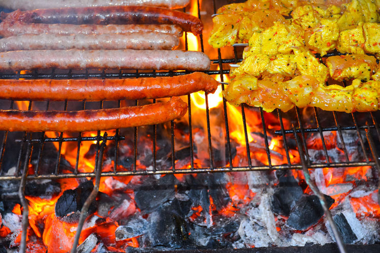 Sausages and chicken skewers on bbq. Barbecue BBQ BBQ Time Beef Burning Chicken Close-up Cooked Day Delicious Flame Food Holidays Hot Meal Meat No People Preparation  Sausage Sausages Seasonal Skewers Spices Summer Tasty