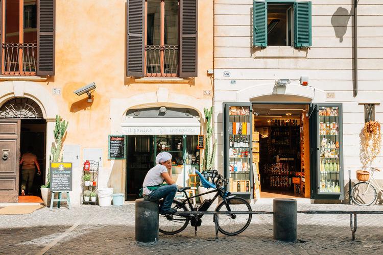 Man sitting at sidewalk cafe