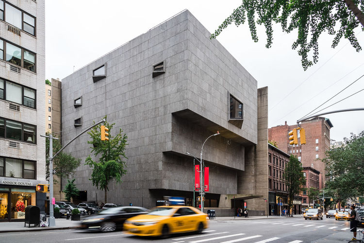 MET Breuer modern art museum in Madison Avenue Architecture Building Exterior Built Structure Outdoors Manhattan New York NYC USA America Whitney Museum Met Breuer Museum Madison Avenue Cultures Architecture Modern Landmark Metropolitan Modern Art Exhibition City Transportation Mode Of Transportation Street Motor Vehicle Car Land Vehicle Road Sign Building Sky Tree Incidental People Plant Nature City Life Motion Office Building Exterior