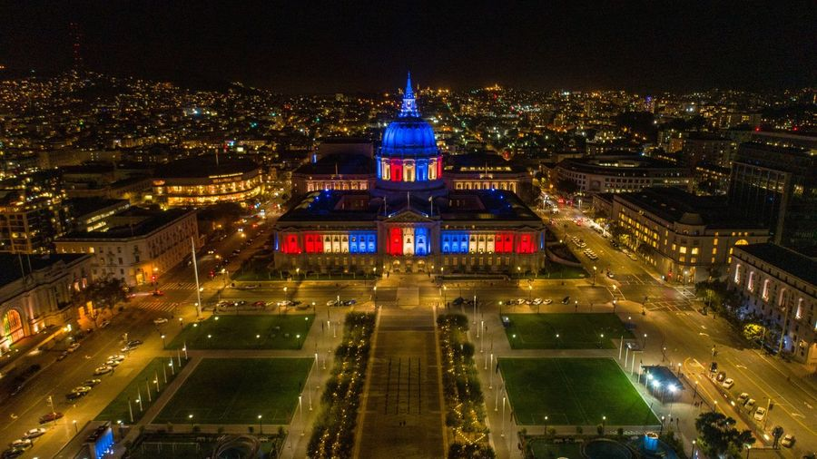 High angle view of illuminated courthouse in city at night