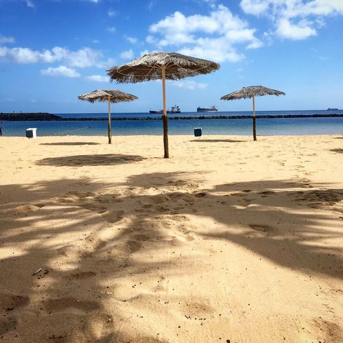 Playa Holiday Leisure Activity Light Palm Tree Holiday Travel Travel Destinations Relaxing Moments Santa Cruz De Tenerife Atlantic Canary Islands Tenerife Island Playa Land Sea Sand Sky Water Cloud - Sky Nature Horizon Over Water Horizon Day Outdoors Shadow Sunlight Shade Beauty In Nature Tranquility Scenics - Nature