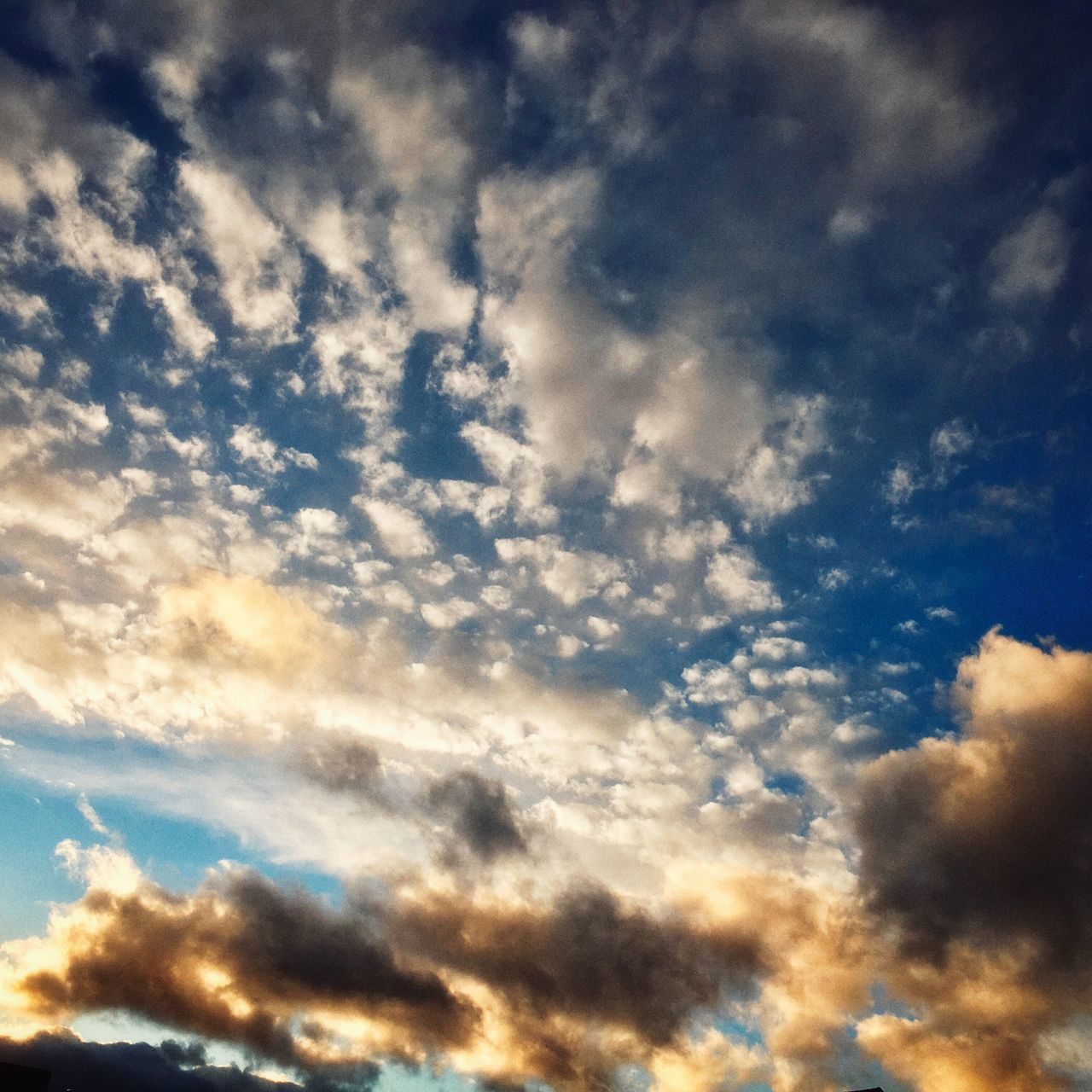 sky, cloud - sky, low angle view, beauty in nature, backgrounds, nature, no people, sky only, dramatic sky, full frame, scenics, tranquility, outdoors, abstract, tranquil scene, day, blue, sunset