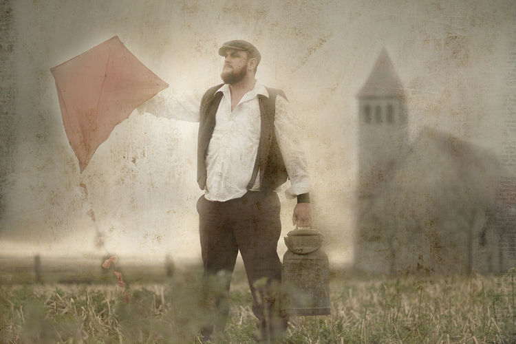 Saint George Adult Allegory Art Art Photography Chubby Chubby Man Church Depression - Sadness Fields Fine Art Photography Foto Art Germany Holding Kite Kite Meadows Milk Churn One Person PastorAleman People Portrait Portrait Man Saint Standing Village Village People
