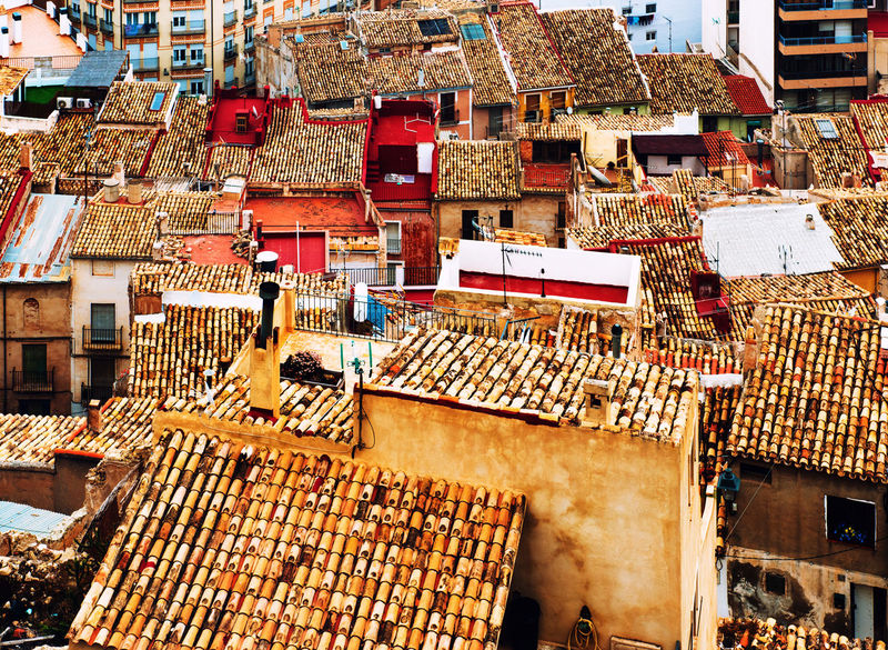 Ceramic tile rooftops of Jijona (Xixona) town. Jijona is a town and municipality in the Valencian Community. Spain Above Alicante, Spain Ancient Architecture Apartments Architecture Ceramic Tiles Costa Blanca Crowded Houses Europe Houses Jijona Mediterranean  Old Buildings Outdoors Residential Building Rooftops SPAIN Sunny Day Town TOWNSCAPE Travel Destinations Typical Houses Urban Scene Village Xixona