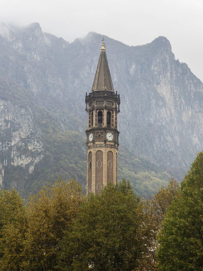 Built Structure Architecture Mountain Tower Building Exterior Plant Tree Building Nature Religion Place Of Worship No People Belief Day Travel Destinations History Spirituality The Past Outdoors Spire  Alps Alps Italy Italia Como Lake