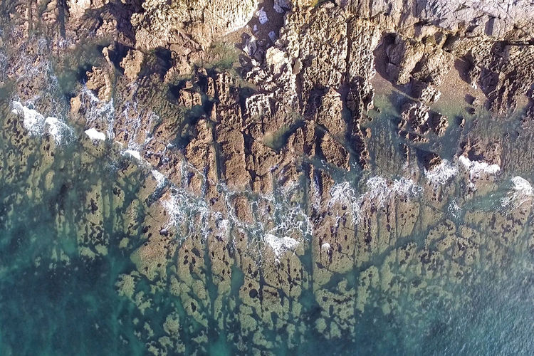 Langland Bay Rocks Drone  Langland Bay Beauty In Nature Close-up Coast Day Dronephotography Full Frame Nature No People Outdoors Rock - Object Rocks Textured  Water