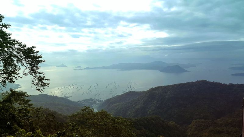 TaalLake  Tagaytay Philippines Philippinesphotography Early Morning View From The Top Viewpoint Lovelyview Beautifulday Photooftheday Nature Tree No People Outdoors Beauty In Nature Fog Tranquility Landscape Mountain Freshness Sky Water Day Forest Scenics