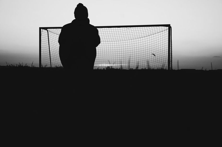 Blackandwhite Photography Blackandwhite Black And White Fussball Football Silhouette Sky One Person Real People Copy Space Standing Lifestyles Nature Men Leisure Activity Clear Sky Sunset Rear View Outdoors Fence Boundary Barrier Three Quarter Length Field The Street Photographer - 2018 EyeEm Awards