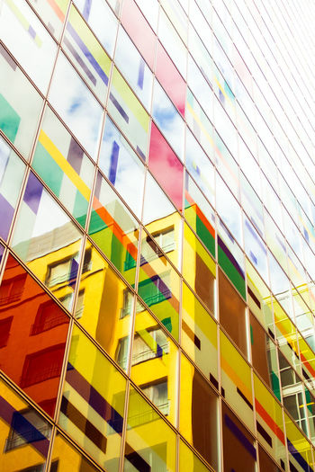 Multi Colored Full Frame Built Structure Pattern No People Architecture Backgrounds Low Angle View Building Exterior Glass - Material Modern Building Geometric Shape Window Day Office Shape Reflection Design Choice Office Building Exterior Fassade