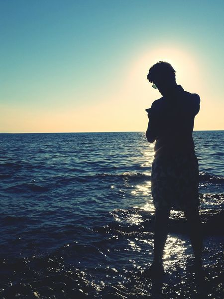 Sea One Person Silhouette One Man Only People Horizon Over Water Beach Full Length Adult Vacations Sky Standing Only Men Water Men Outdoors Adults Only Summer Sunset