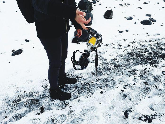Full length of man standing on snow covered land