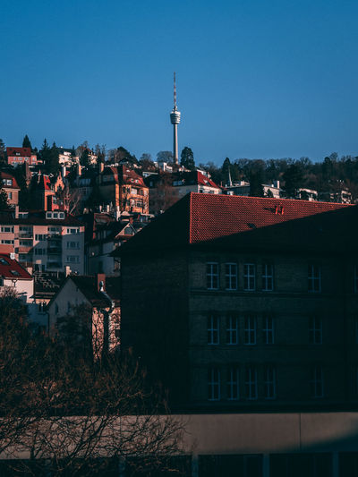 Stuttgart TV Tower Architecture Blue Building Building Exterior Built Structure City Clear Sky Day House No People Outdoors Residential District Roof Sky Spire  Tower Town Travel Destinations Tree
