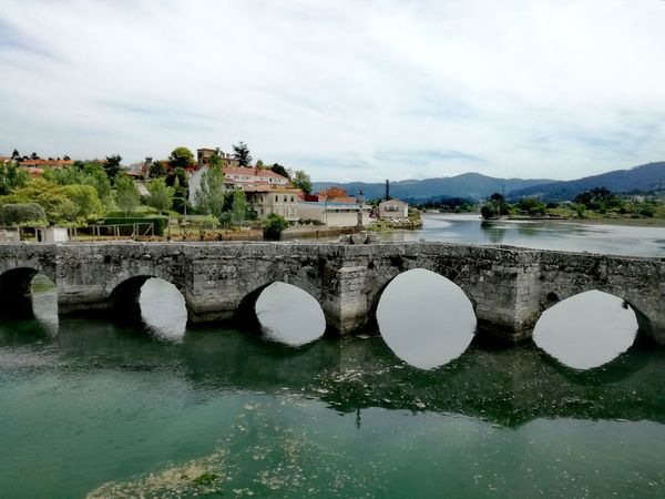 Water Mountain Sky Outdoors Cloud - Sky Day No People Architecture Tree Landscape Building Exterior Nature Bridge Bridge - Man Made Structure Historical Monuments Historical Site Spainish Architecture, Spain Galicia Spain Spanish Culture Romanesque Architecture Romanesque, Gothic And Baroque Architecture