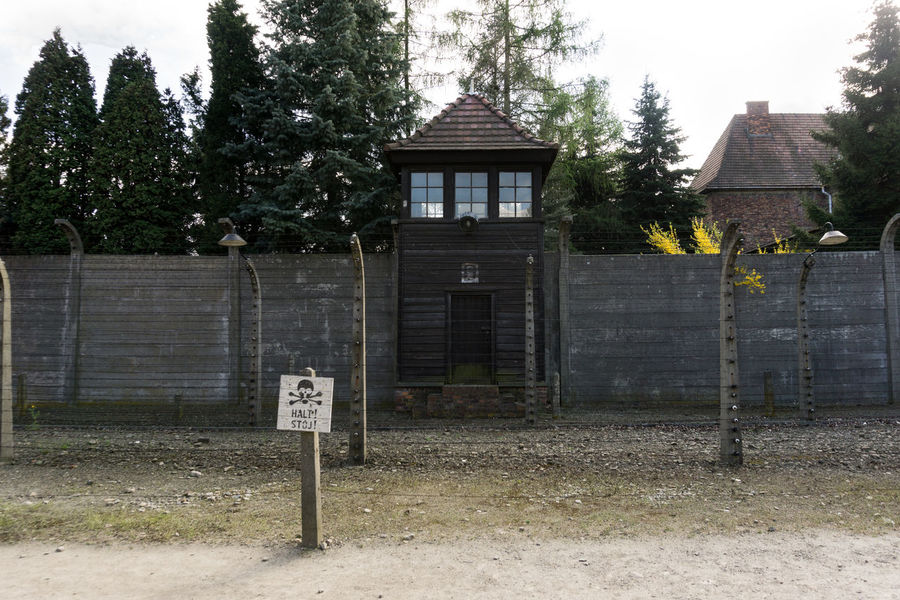 auschwitz / behind these walls were the residences of the officers Architecture Building Exterior Built Structure Closed Day Door Entrance Façade Front Door House Outdoors Outside Tree Tree Trunk