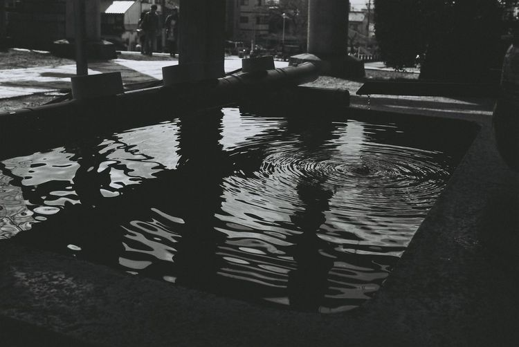 Canon Film EOS1 Filmphotography 35mm Film 35mm Japan Kyoto Monochrome Black And White Blackandwhite Streetphoto_bw Photography In Motion Peoples Peoplephotography Water Water Reflections Waterdrops