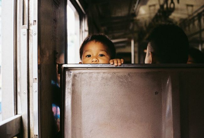 child on the train : Photo by Flim camera Transportation Portrait Childhood Smiling Cute Happiness Baby Cheerful