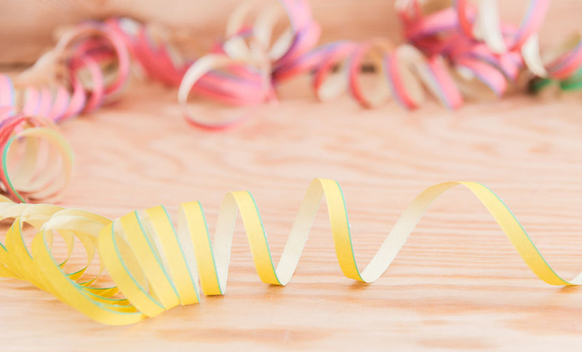 Paper snakes for your party or birthday or carnival just have fun Indoors  Close-up No People Table Celebration Ribbon Still Life Freshness Food And Drink Ribbon - Sewing Item Food Pink Color Wood - Material Focus On Foreground Event Cupcake Group Of Objects In A Row Sweet Streamer Paper Streamers Carnival