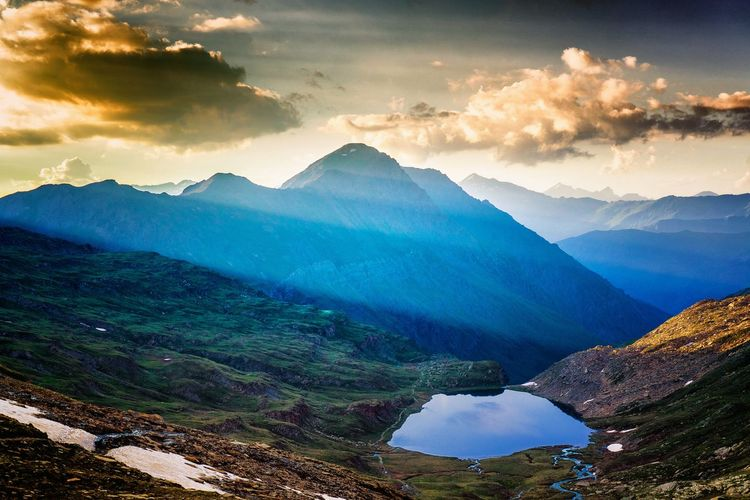 Scenic view of lake by french alps against sky