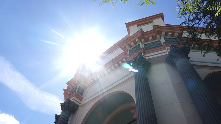 Disneyland Ariel Little Mermaid  Turquoise Building Exterior Low Angle View Sunlight Architecture Sky Sunbeam No People Outdoors Sun Day Built Structure Lens Flare