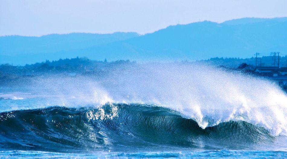 Waves Crashing And Splashing In Sea
