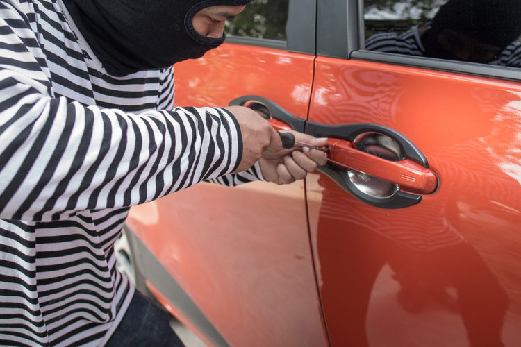 Thief opening car door
