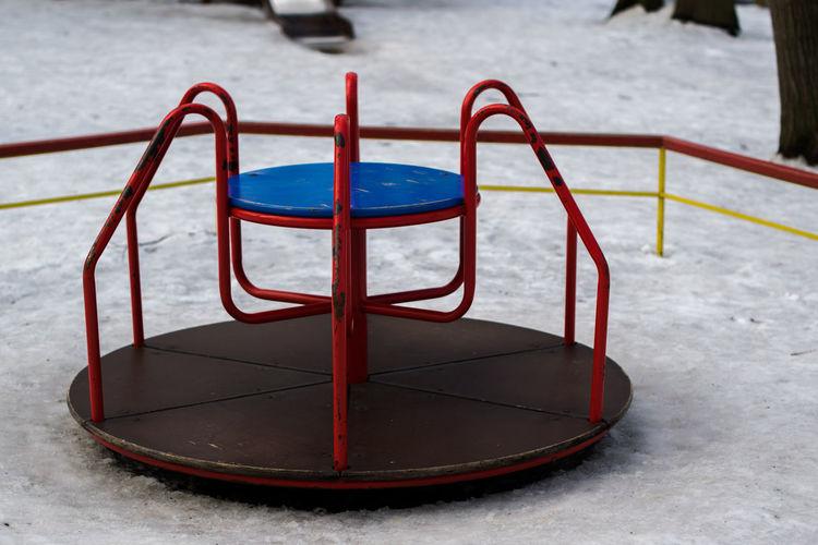 Merry-go-round at playground during winter