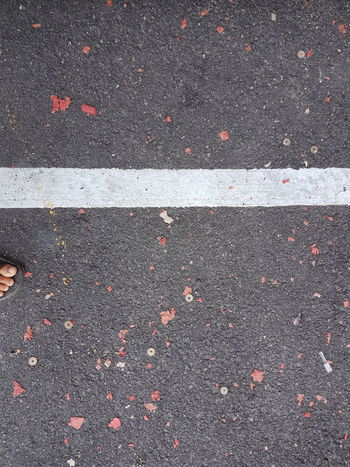 Asphalt High Angle View Marking Day Road Textured  Outdoors LINE Feet On The Ground Divider Dividing Line White Line Gravel Asphalt Road Abstract Art Paths Of Life Above View Top View Step Moving Forward  Beauty In Ordinary Things Firecracker Background Textures And Surfaces Texture