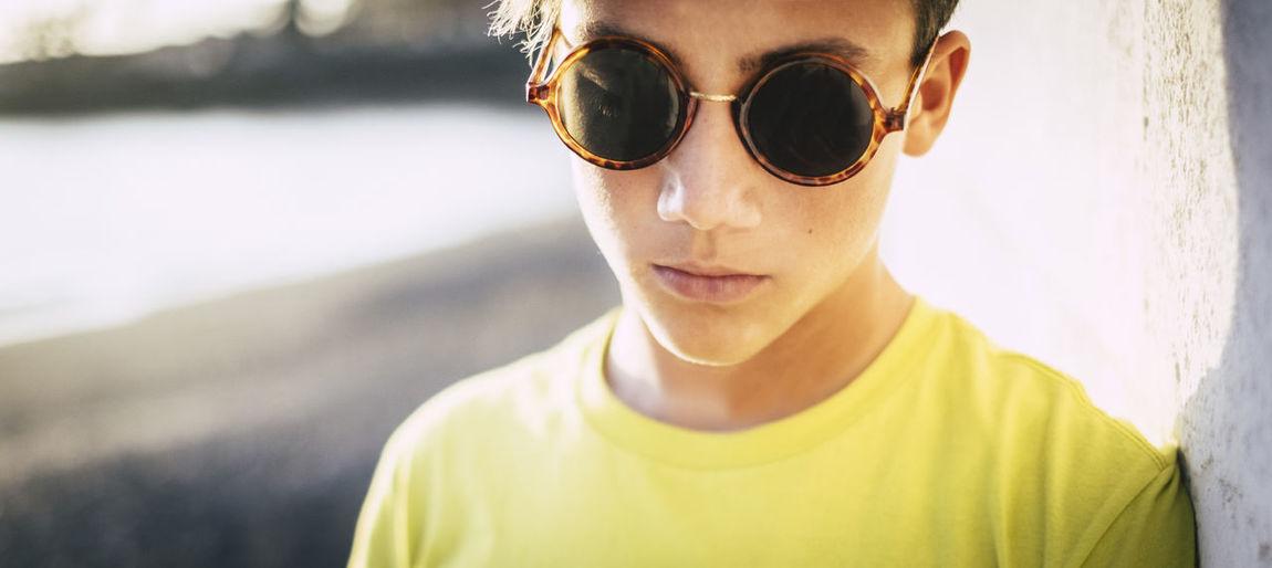 Close-up of teenage boy wearing sunglasses