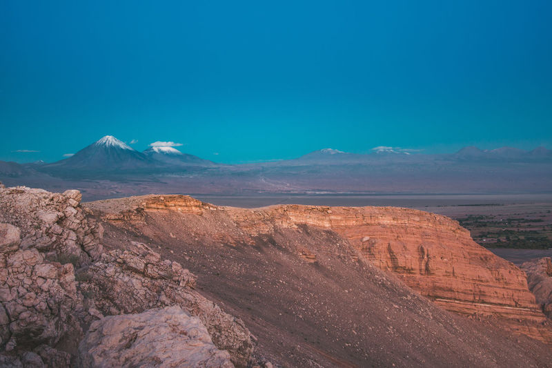Exploring the surroundings of San Pedro de Atacama, Chile. Blue Hour Desert Latin America Mars Nature Planet Earth Scale  Tranquility Travel Adventure Arid Climate Blue Cliff Dry Explore Landscape Mountain Mountain Range No People Outdoors Scenics Snow Snowcapped Mountain South America Travel Destinations