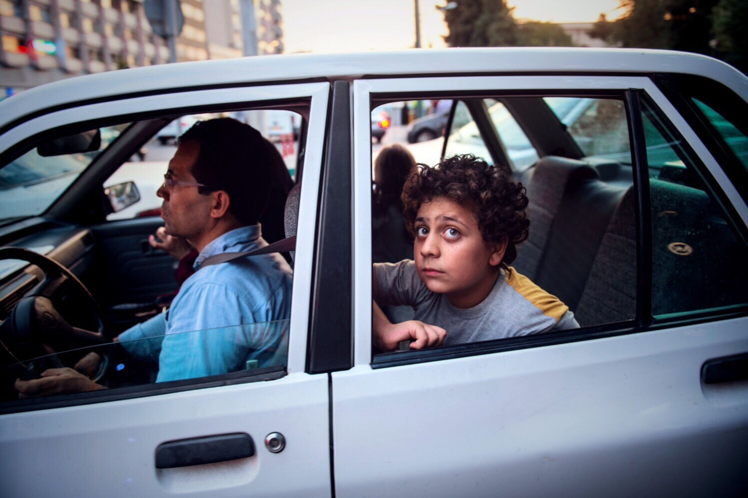 car, two people, driving, only men, transportation, window, men, looking through window, adults only, adult, headshot, people, outdoors, day