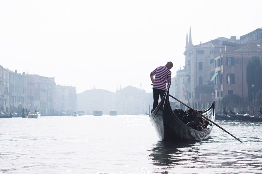 Adapted To The City Venice Canals Gondola - Traditional Boat Gondolier Nautical Vessel Striped Cultures One Person Rear View Transportation Travel Destinations Water Taxi Outdoors Adults Only Water Building Exterior Venice France Enjoy Sightseeing Tour Gondola Canals Happy Group Of People EyeEm Selects