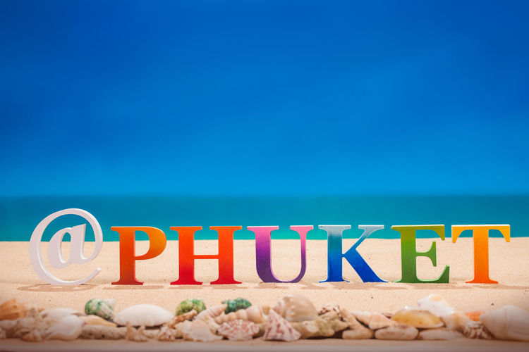 @Phuket written in colorful wood letters with sea shell at the beach with copy space Alphabet, Phuket,Thailand Textured  Travel Animal, Beach Communication Land Message Nature No People Sand Text