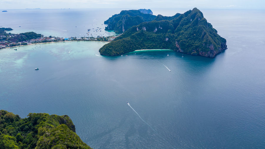 Phi phi island and tourist boat at krabi thailand aerial view