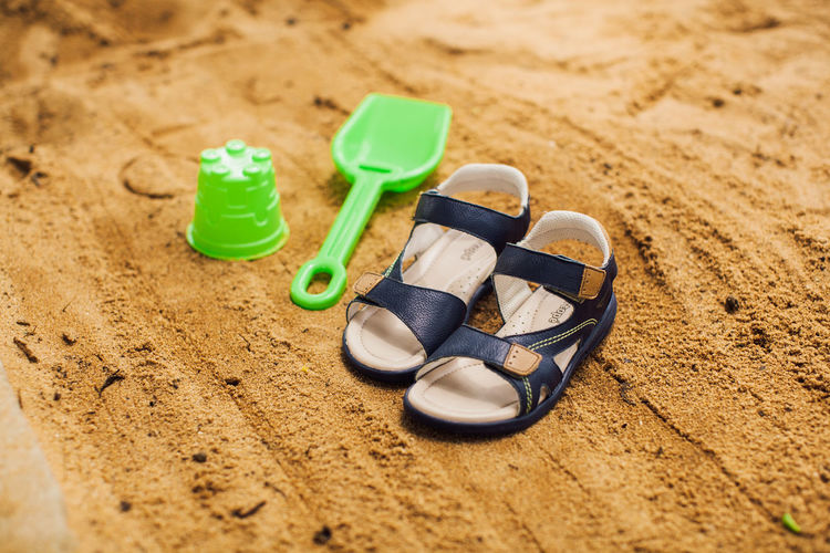 Beach Choice Close-up Day Flip-flop Group Of Objects High Angle View Land Nature No People Outdoors Pair Personal Accessory Plastic Sand Sandal Selective Focus Shoe Slipper  Still Life Toy