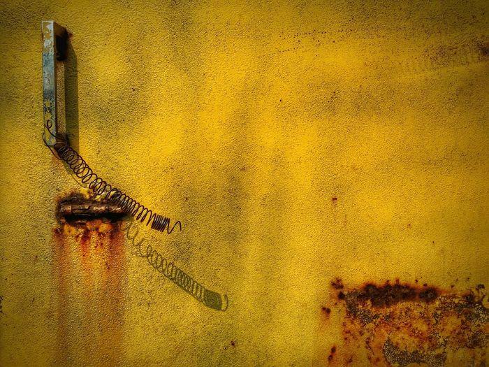 Full frame of rustic yellow door
