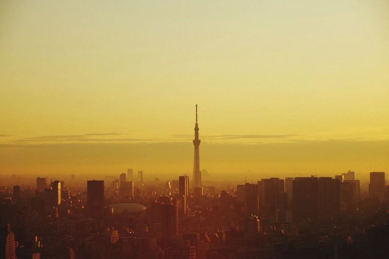 Tokyo sky tree with cityscape against sky during sunset