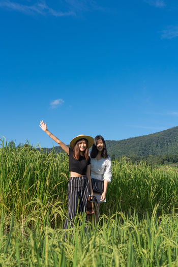 Asian  Asian Girl Women Blue Sky Sky Two People Plant Field Grass Land Togetherness Nature Blue Real People Leisure Activity Emotion Happiness Standing Landscape Young Adult Environment Casual Clothing Positive Emotion Outdoors Paddy Field