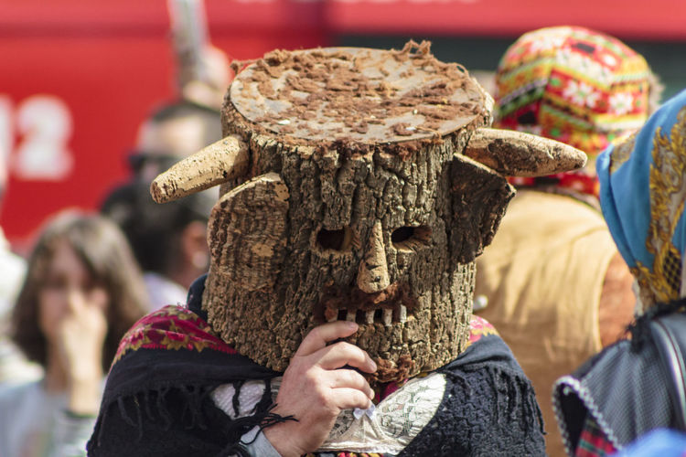 Man wearing costume on street during festival