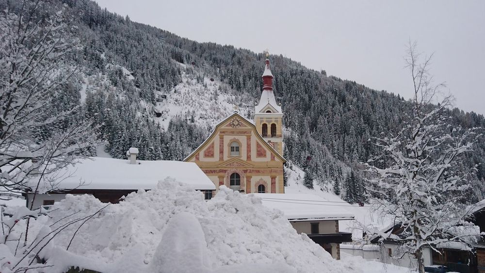Pfarrkirche Obertilliach Architecture Building Exterior Built Structure Mountain Winter Snow History Travel Destinations Religion Outdoors Cold Temperature Spirituality Shades Of Winter