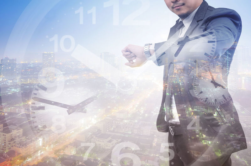 Double exposure of a businessman and a city, look his watch. Exposure Double Business Businessman City Concept Man Professional Background Suit Success Male Modern Office Digital Work Job Building People Technology Looking Creative Manager Marketing Time Clock Watch Management Late person Corporate Busy Deadline Worker Wristwatch Checking Look Executive  Wrist Punctual Punctuality Hour Idea Future
