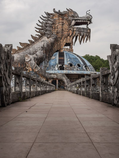 Abandoned Water Park near Hue Architecture Sky Built Structure Nature No People Cloud - Sky Day Water Sculpture Animal Representation Art And Craft History The Past Direction Representation Connection Old Outdoors Animal Urbex