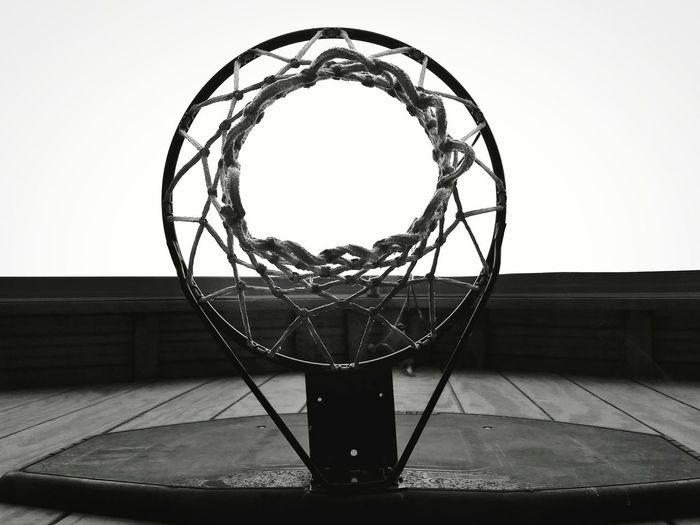 Straight on photo of centered basketball hoop in black and white. Looking up? Or looking down? May Theme Looking Up Basketball - Sport Sport Basketball Hoop Court Net - Sports Equipment Leisure Games Close-up No People Day Straight On View Against The Sky Black And White Outdoors BYOPaper! The EyeEm Collection Directly Below The Premium Collection