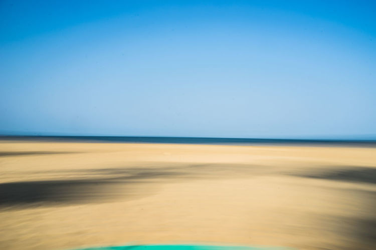 motion by the ocean Beach Beauty In Nature Blau Blue Blur Blurred Motion Braun Clear Sky Day Horizon Horizon Over Water Horizont  Landscape Motion Blur Nature No People Outdoors Sand Scenics Sea Sky Strand Sunlight Tranquil Scene Water