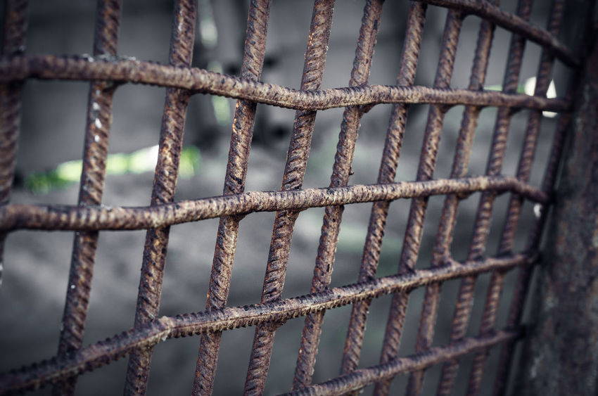 Metal lattice welded from reinforcement Backgrounds Barrier Boundary Close-up Day Fence Focus On Foreground Full Frame Grid Iron - Metal Metal No People Outdoors Pattern Prison Protection Punishment Rusty Safety Security