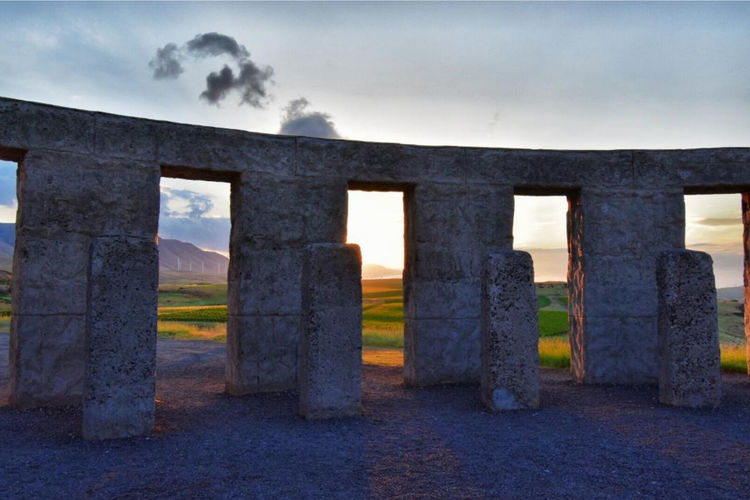 Stonehenge WWI Memorial, Maryhill, Washinton. Built by Sam Hill in 1918, it is the first WWI memorial within the United States. Standing inside is like being in a giant zeotrope, thirty different views of the Columbia Gorge. Columbia River Gorge Stonehenge Memorial Washinton State Zoetrope Architecture Built Structure Cloud - Sky Day History Land Landscape Nature No People Old Ruin Outdoors Sky Stone Stonehenge Sunrise The Past Travel Travel Destinations
