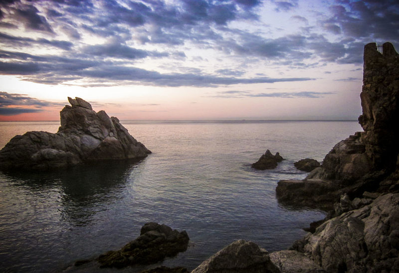 Rocks at Dawn, Lloret de Mar is a Mediterranean coastal town in Catalonia, Spain. One of the most popular holiday resorts on the Costa Brava Lloret De Mar Beauty In Nature Catalonia Cloud - Sky Horizon Over Water Idyllic Mediterranean  Mediterranean Seascape Nature Non-urban Scene Rock - Object Rock Formation Rocks And Water Scenics Sea Seascape Sky SPAIN Tourism Tranquil Scene Tranquility Travel Travel Destinations Vivid International Water